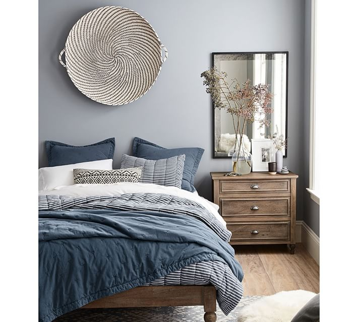 Great statement basket as wall art over a bed - love this and other ideas for above the bed decor in this post!