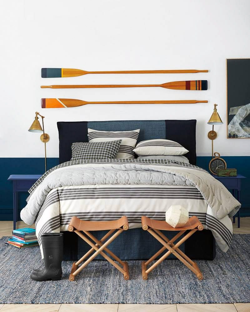 Loving the trio of colorful oars as above the bed decor!