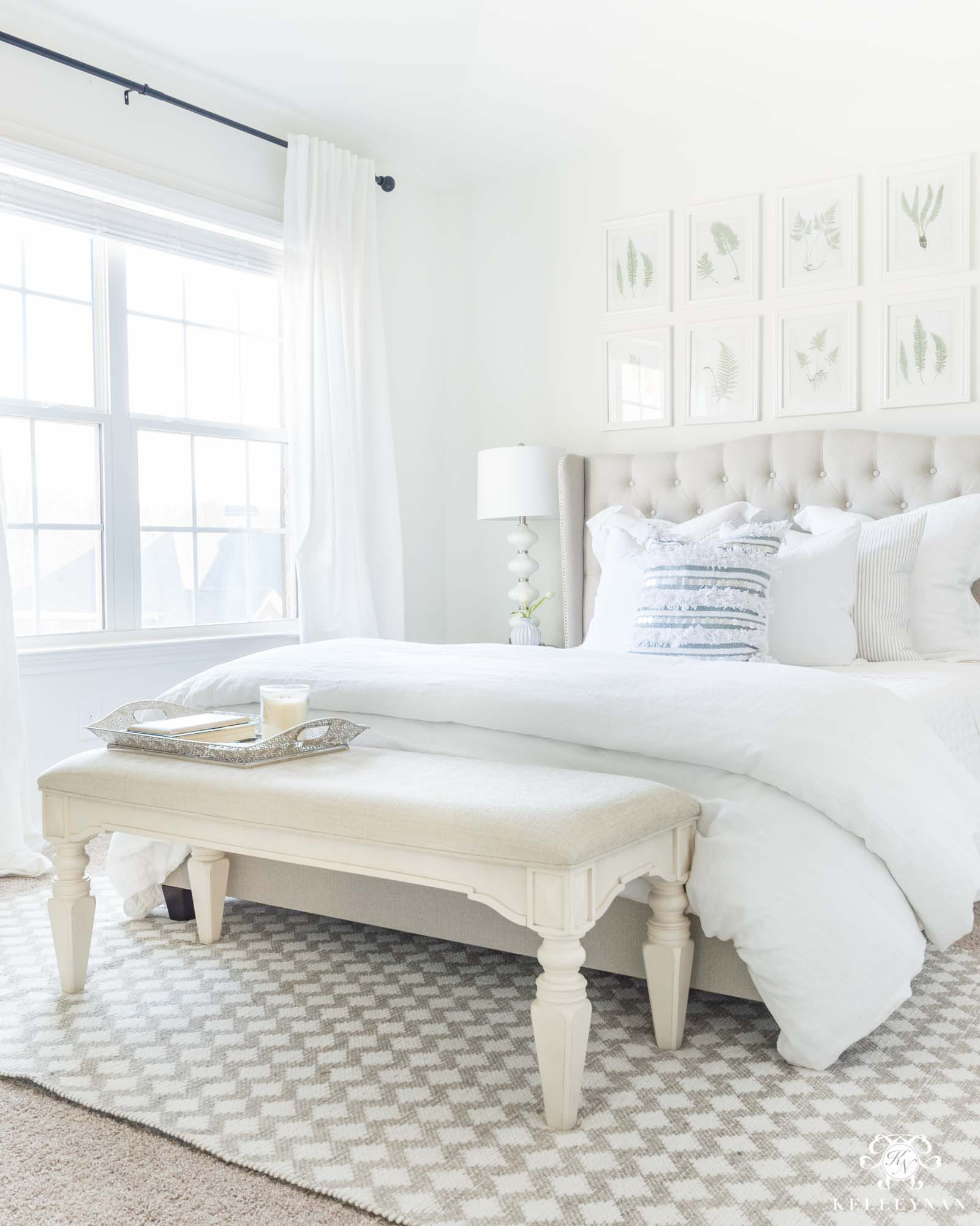 Loving this grid of art wall above the bed by Kelley Nan