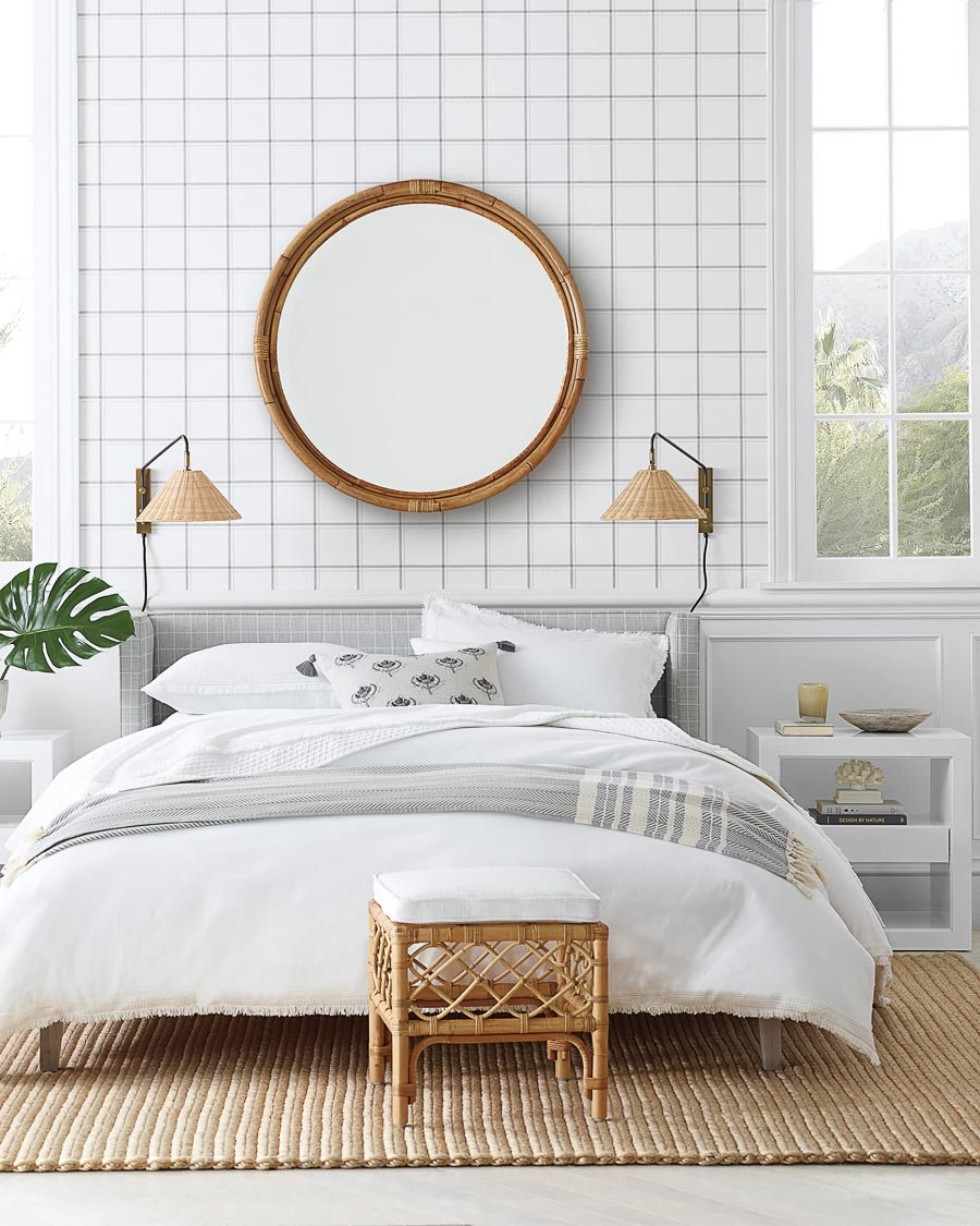 Loving this large round mirror above the bed! Lots of great ideas for above the bed decor in this post!