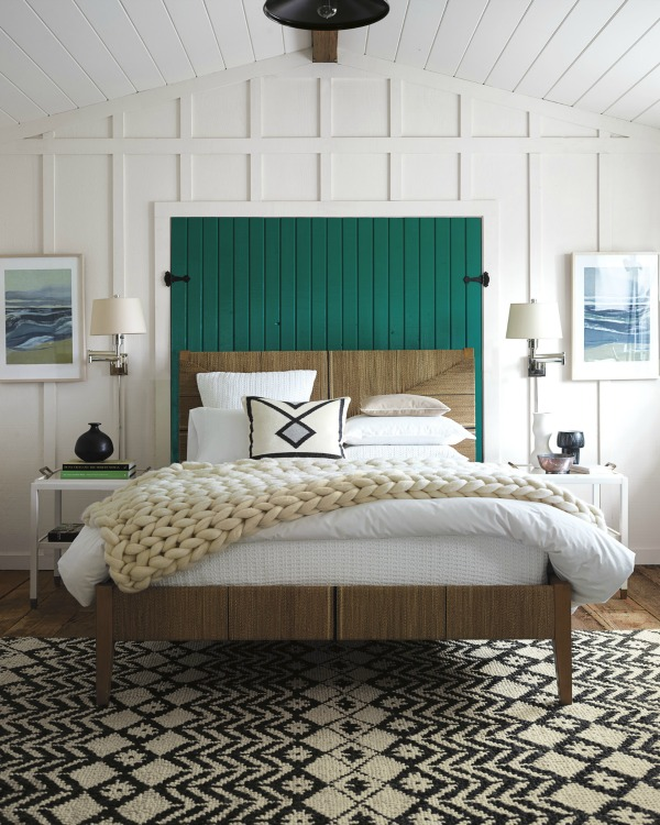 Faux Shutters Decorate The Space Above The Bed