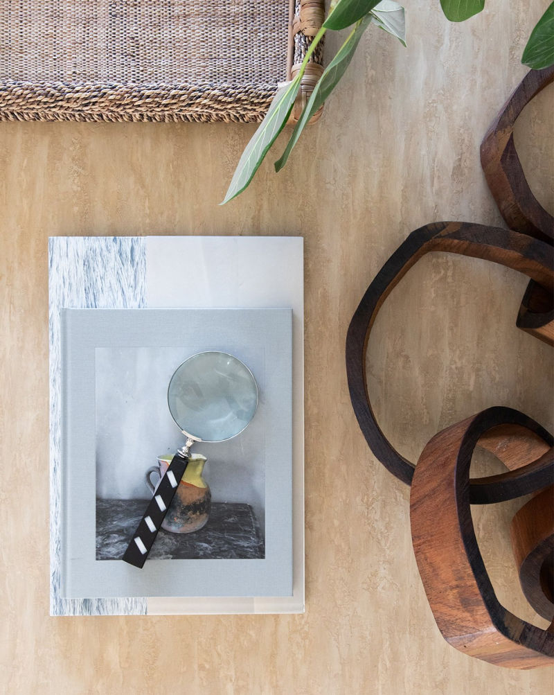 Love the look of a decorative magnifying glass on coffee table books!