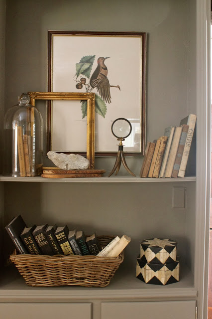 Love this upright decorative magnifying glass as shelf decor!