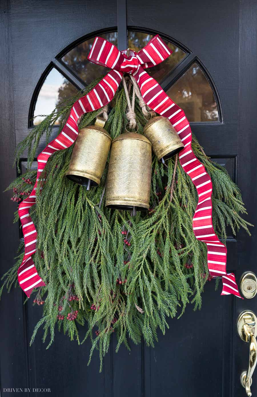 The Christmas door swag on our front door - post includes full tutorial!