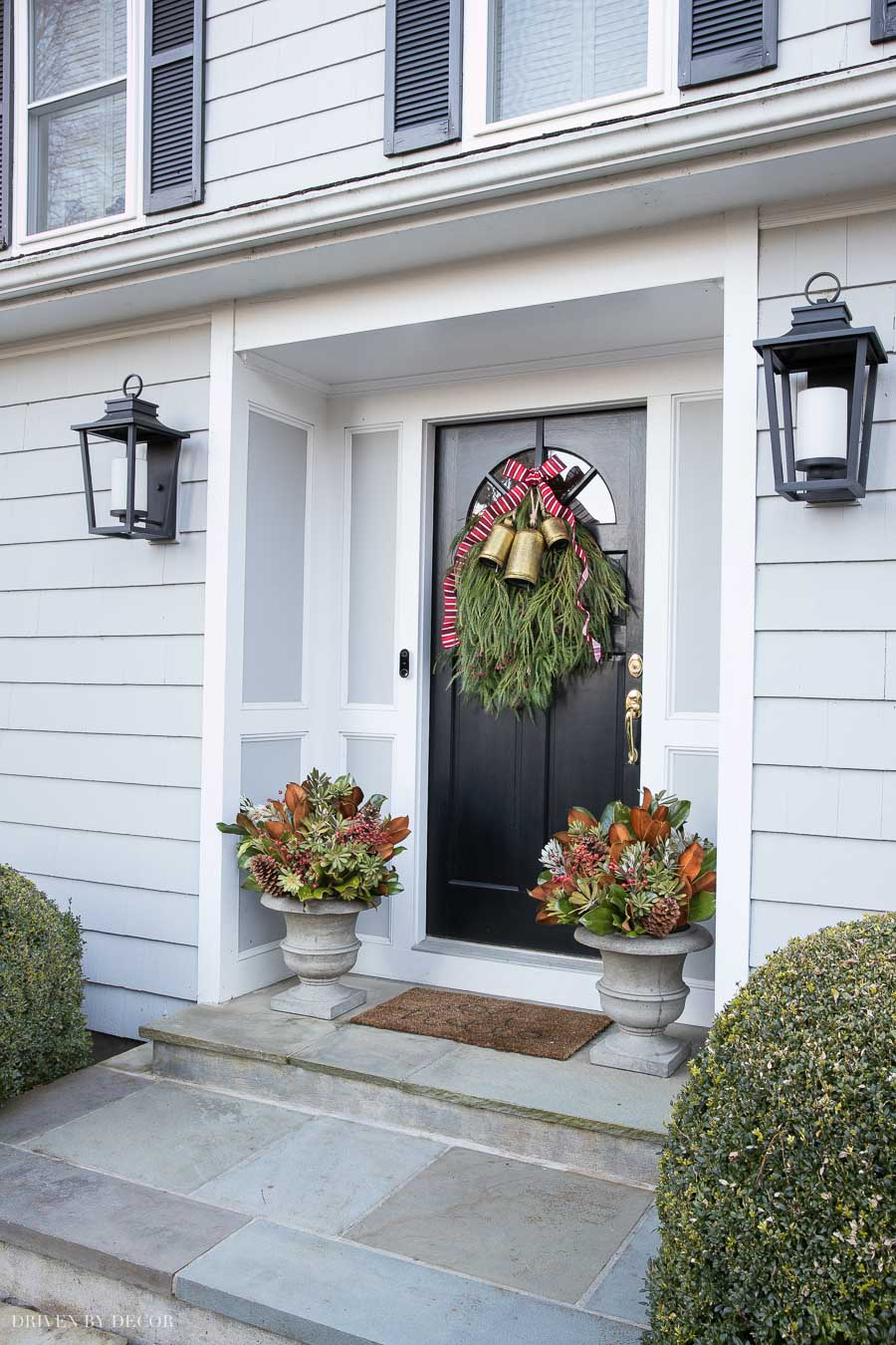 Our Christmas front porch with a DIY door swag and planters - how-to included in post!