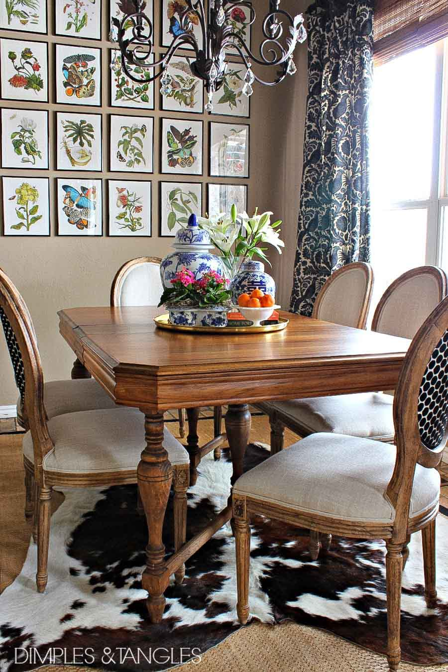 Love the look of a cowhide layered over a rug like this kitchen dining space by Jennifer of Dimples & Tangles