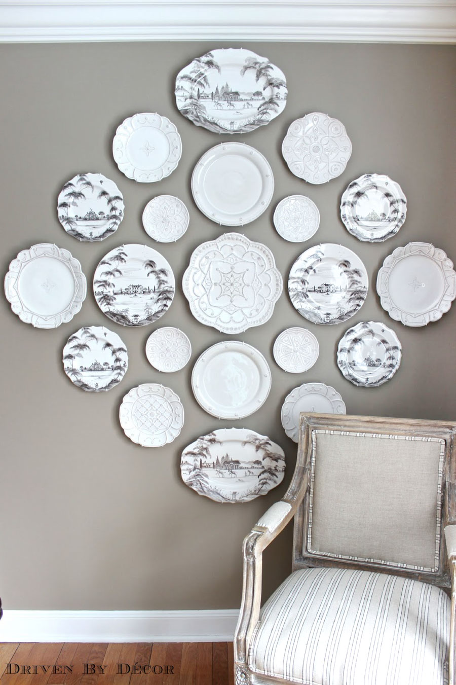 Gorgeous decorative plate wall! This post shows the step by step for how to hang plates on the wall (so they don't fall!)