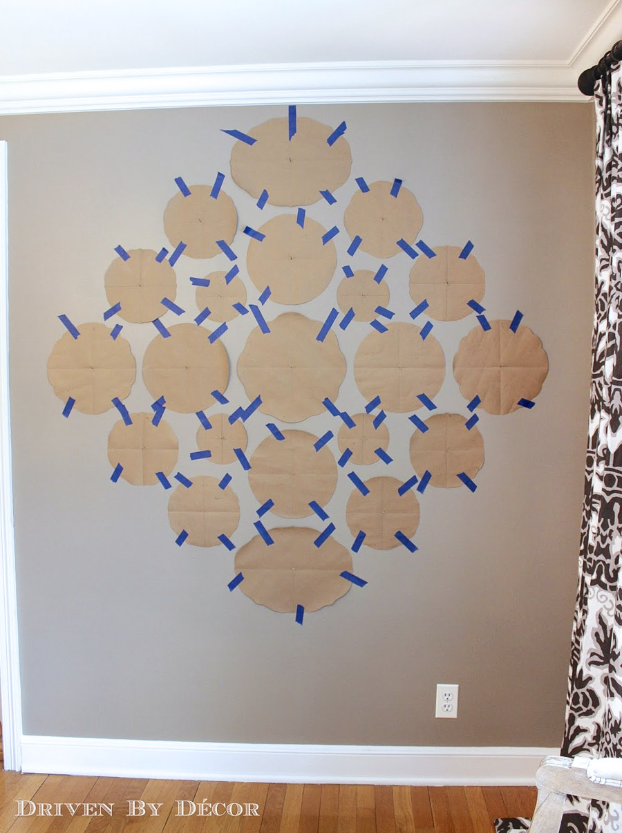 Trace each plate on paper and tape it on the wall before hanging your plates!