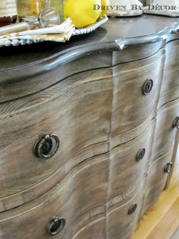 Weathered gray chest in entry