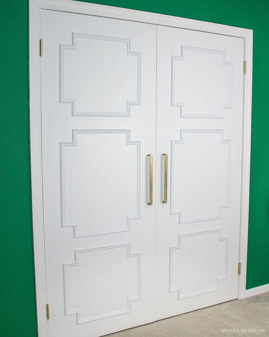 I'm so going to do this to our flat closet doors! Love this flat panel door makeover!