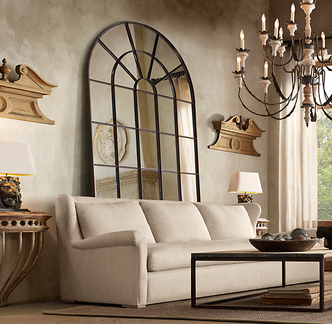 Love the look of having an oversized palladian leaner mirror behind a sofa!