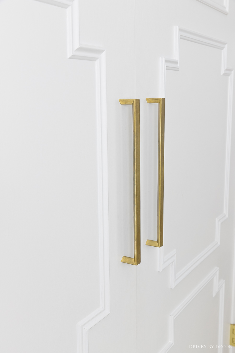 Long gold pulls dress up these closet doors - love this flat door makeover!