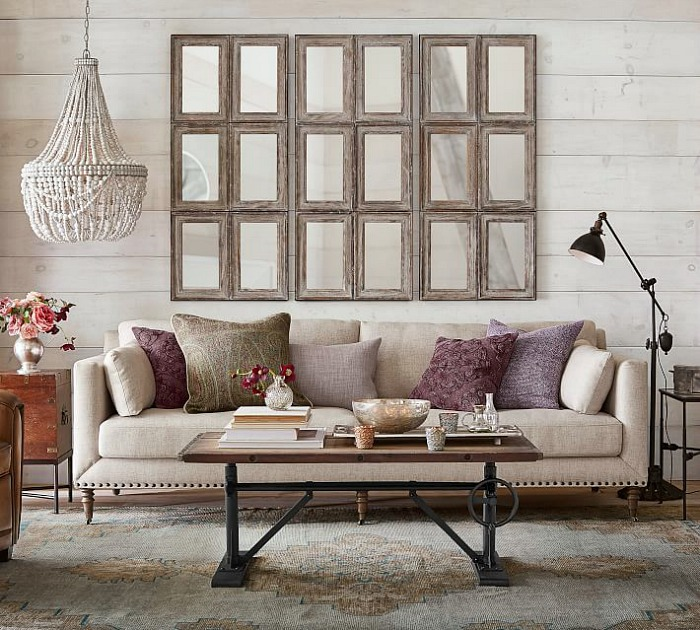 Love this fabulous arrangement of multi-paned mirrors above the sofa!