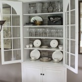 Pergo added to back of glass front cabinet for a beautiful backdrop!