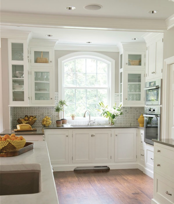 Beautiful white kitchen with arched window