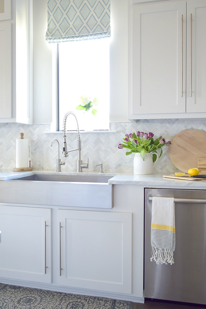 Wondering how high to go with your kitchen backsplash? Cutting it off at the bottom of your cabinets is one great option!