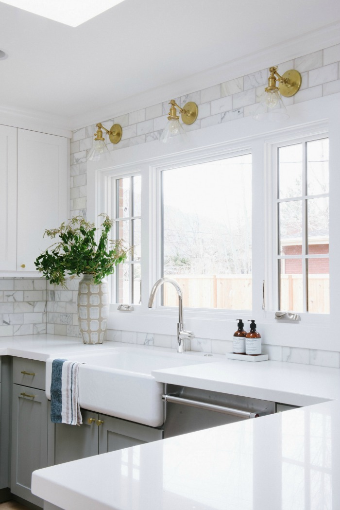 Great post about how high to take your kitchen backsplash - love it all the way around the window!