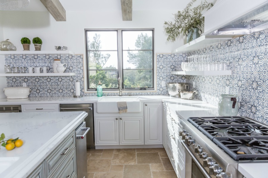 Wondering how high up on the wall to take your backsplash tile? I love how South Harlow Interiors handled their backsplash tile in this kitchen with open shelving!