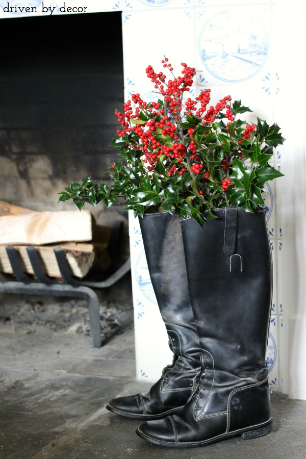 "Keep holiday decorating simple by using what you already have - a mason jar slipped into a pair of riding boots is the perfect ""vase"" for holiday greenery"