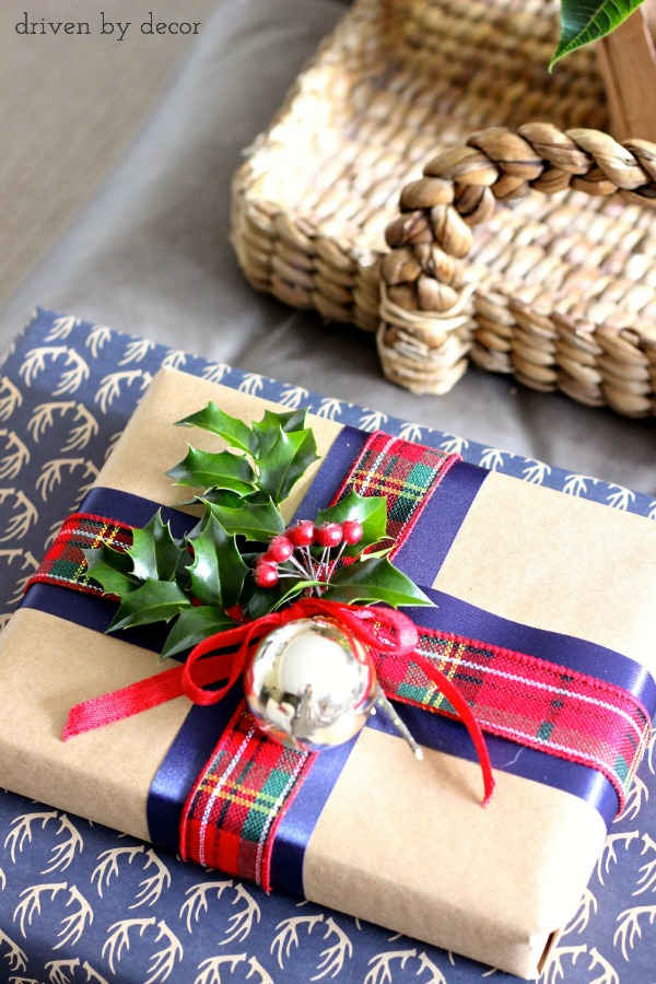 Christmas presents with layered ribbon, holly, and gold ornament