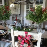 Dining room centerpieces of greenery mixed with berry branches