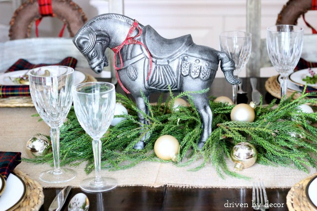 Horse, greenery, and gold ornaments as holiday centerpiece