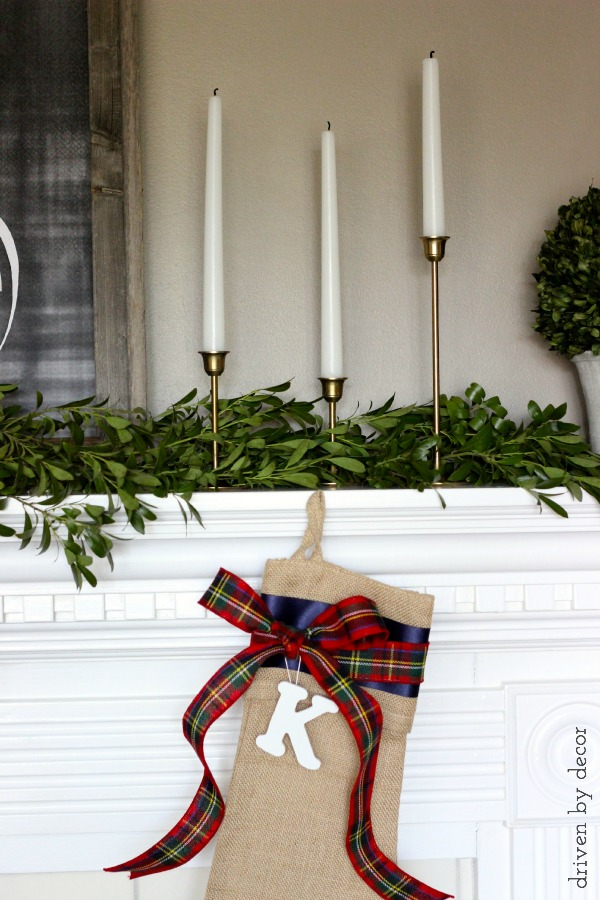 Tapered brass candlesticks on holiday mantel