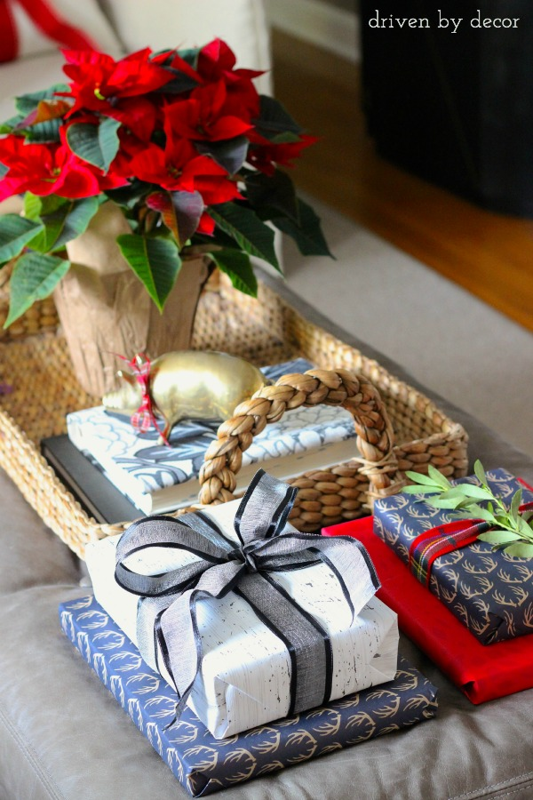 Wrapped presents decorated this living room ottoman for the holidays