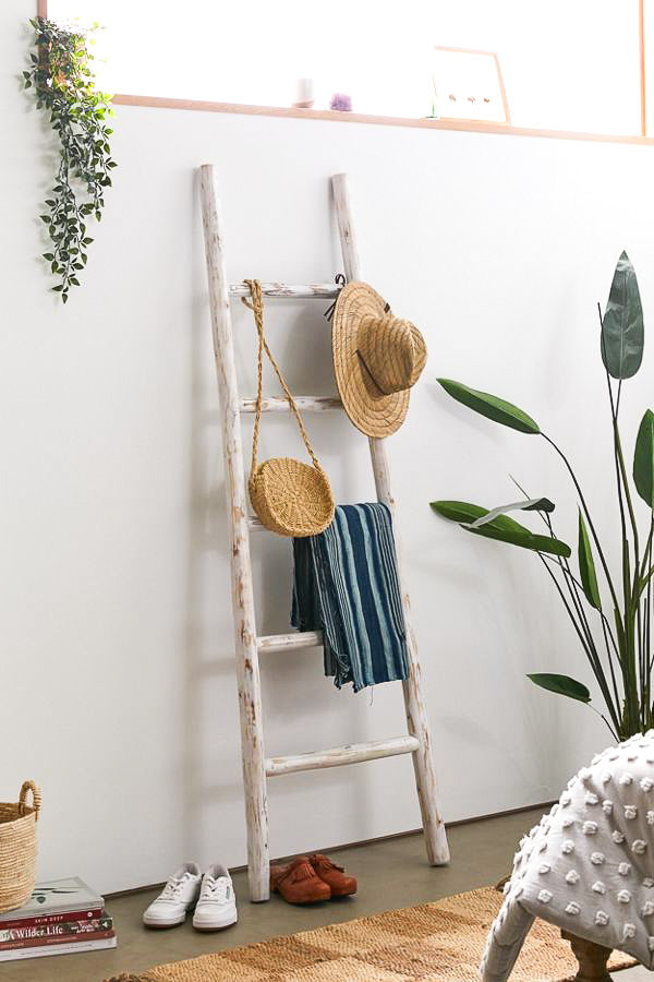 This blanket ladder is perfect for living room corner decor to fill an empty space!