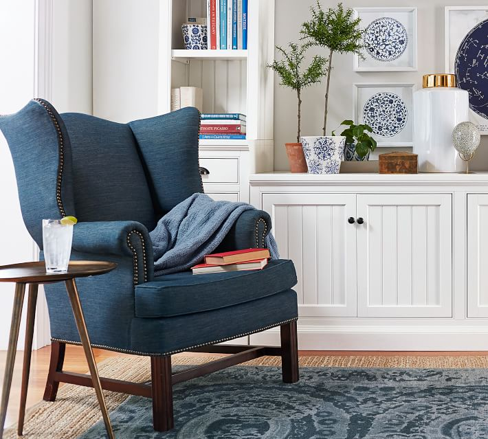 Create a cozy reading nook with a comfy chair and small side table - great way to fill and empty living room corner!
