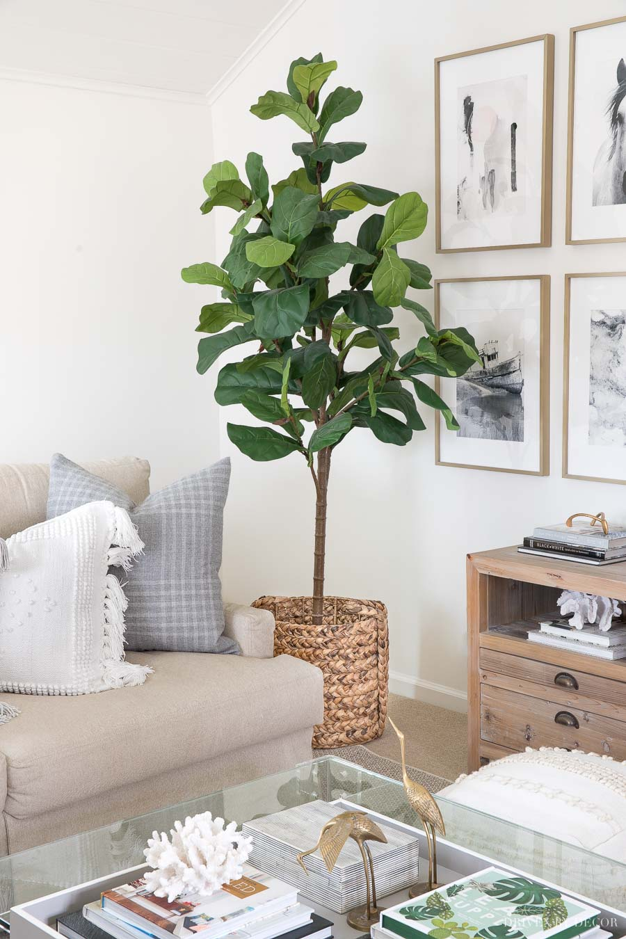 Looks so real! A faux fiddle leaf fig tree in a woven basket fills this living room corner beautifully!