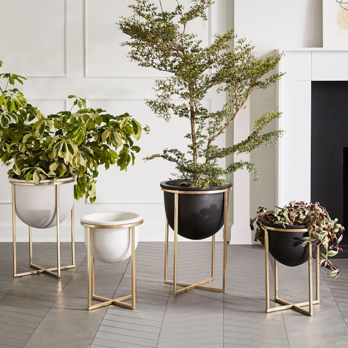 A group of these planters would be perfect decor for a bare living room corner!