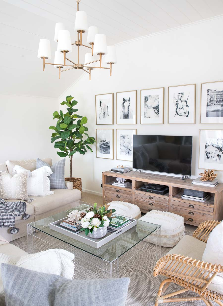 Of all the living room corner ideas, this is my fave - a faux fiddle leaf fig tree in a woven basket!