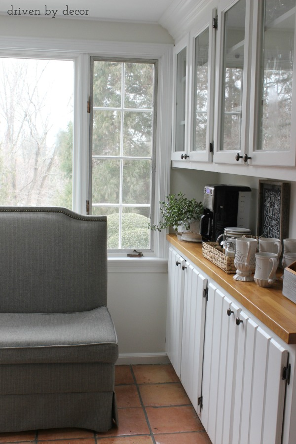 Kitchen with butcher block countertops || coffee station || upholstered bench seat