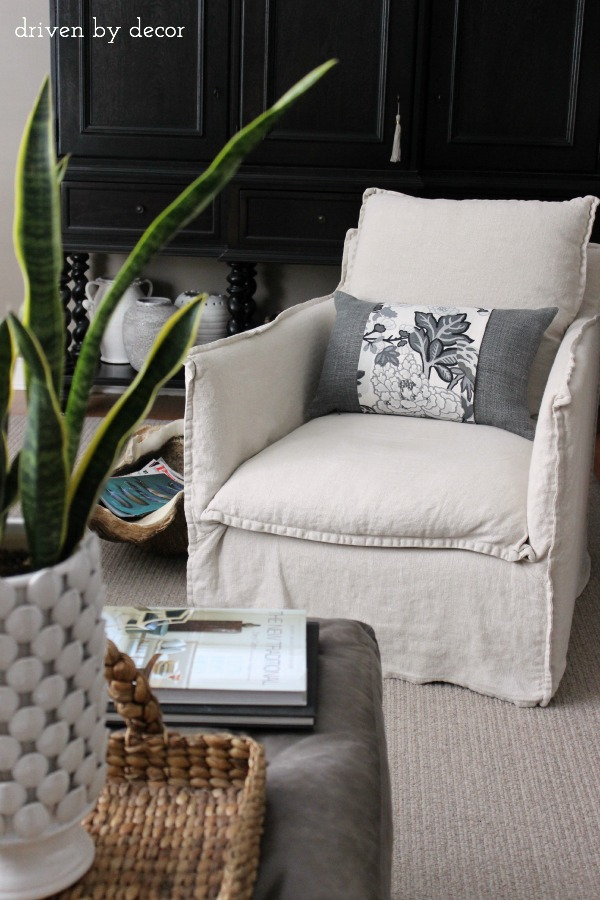 Love these slipcovered swivel chairs - they're the ones our whole family fights to sit in!