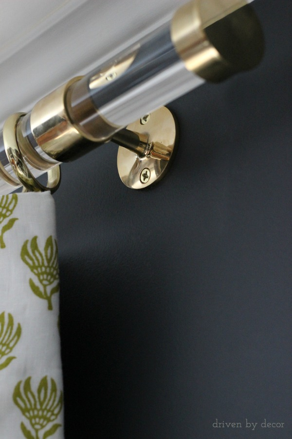 Brass support for acrylic drapery rod