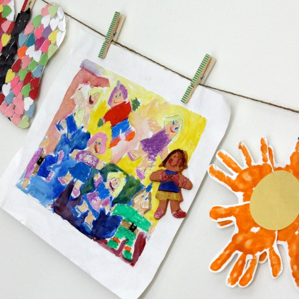 Displaying your child's artwork by clipping it on to twine or ribbon