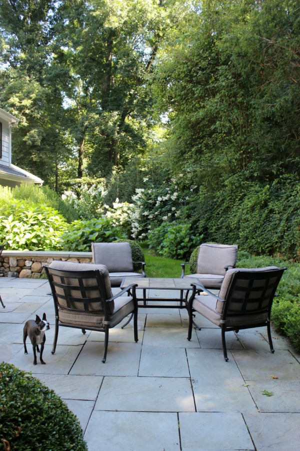 Flagstone patio with a four chair conversation area