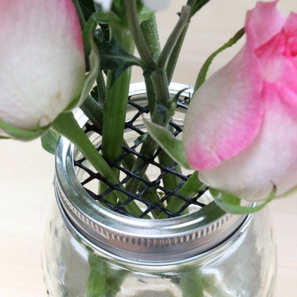 Gutter guard mesh placed in the lid of a mason jar is a great trick for arranging flowers