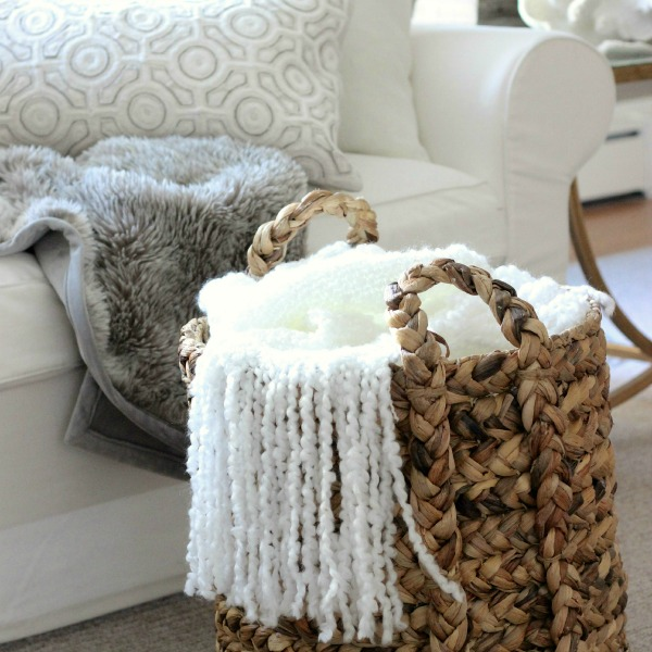 Keep a woven basket filled with cozy throws in the family room