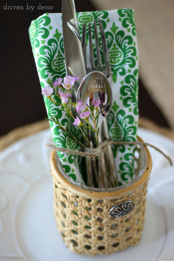 Tie a small floral sprig with silverware