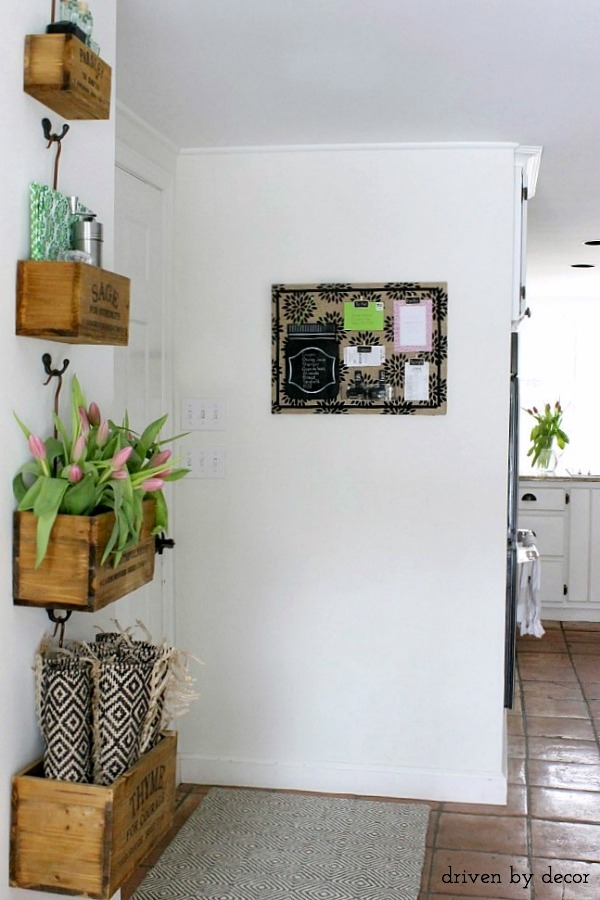 Hanging herb crates and DIY patterned burlap bulletin board