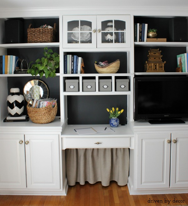 Home office bookcase with DIY skirt to cover cord clutter