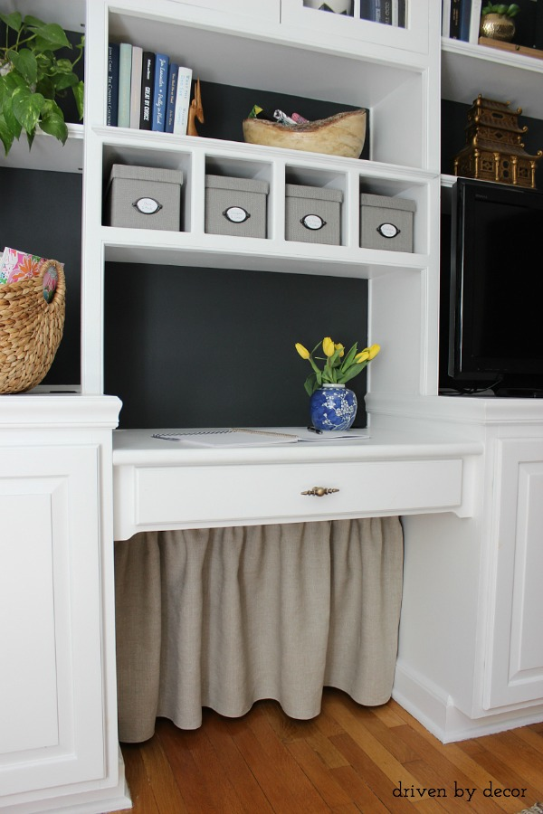 Simple DIY skirt used to hide all of that under the desk cord clutter!