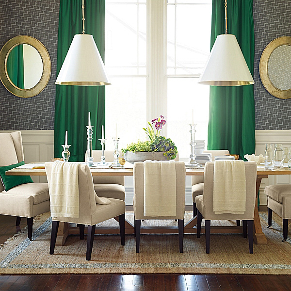 LOVE the look of this pair of cone pendants over a dining table!
