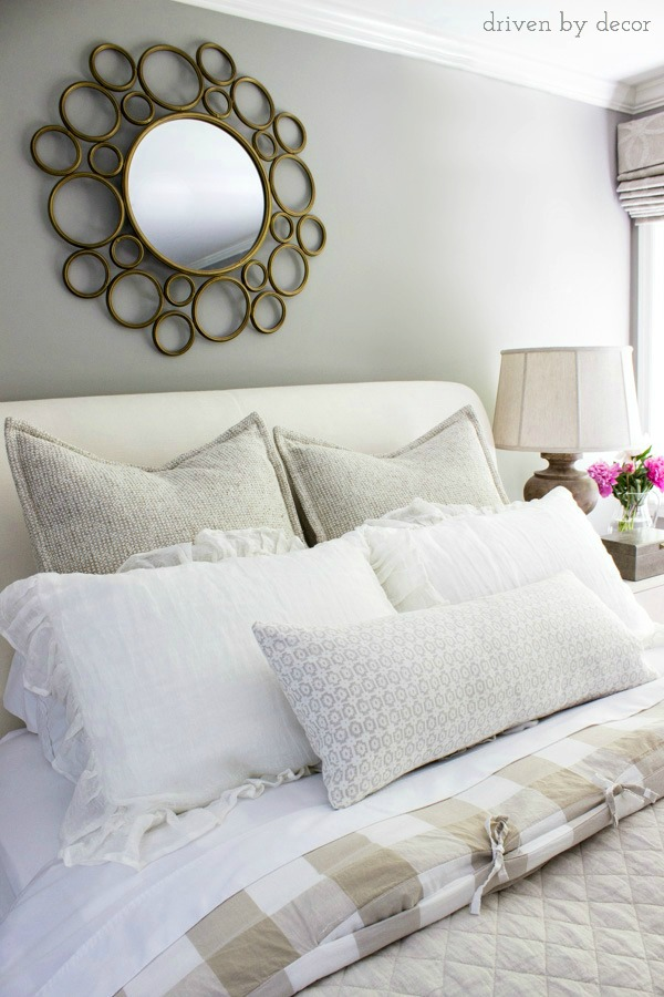 A pair of euro shams, a pair of standard shams, and a lumbar pillow are perfect for a queen bed