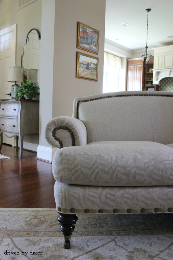 Love the nailhead trim and casters on this sofa