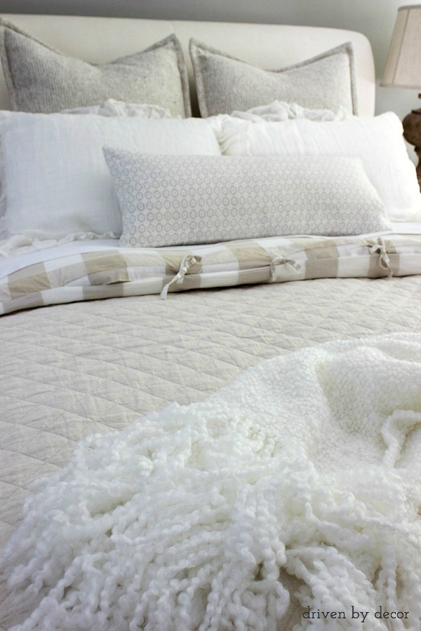 Place a comfy throw at the foot of the bed
