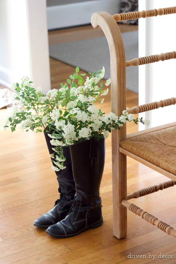Place mason jars inside of a pair of boots and fill with fresh flowers