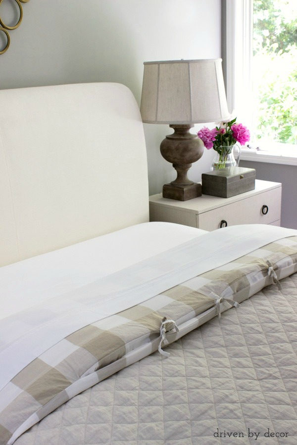 Pull your sheet and duvet back to create an inviting bed